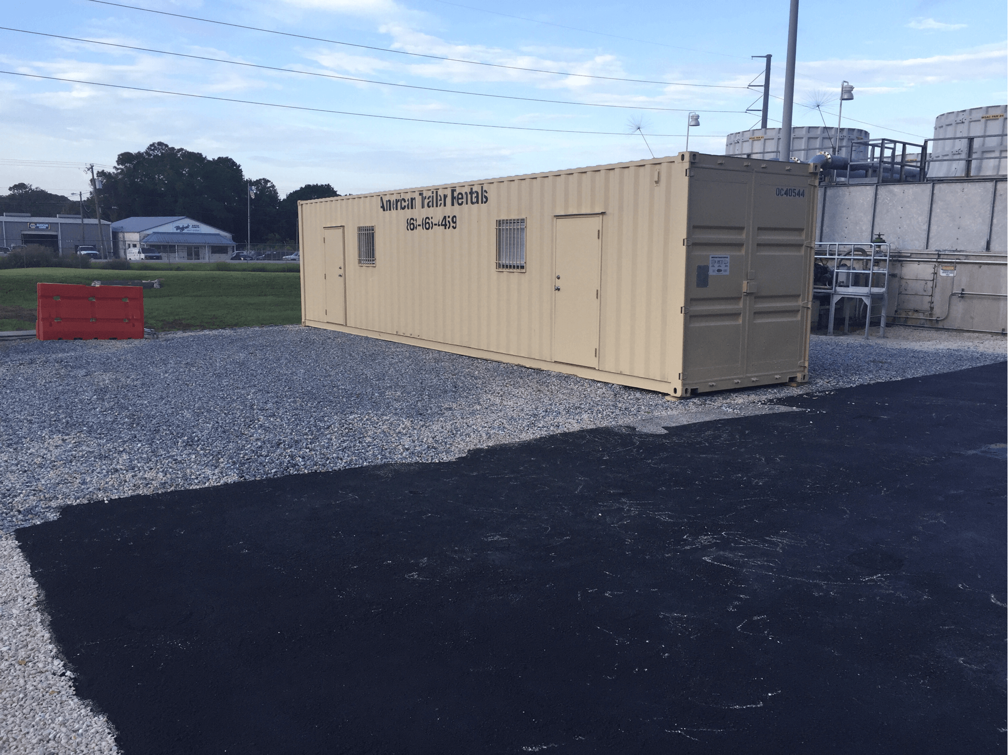 tan 40' office container with two doors and windows