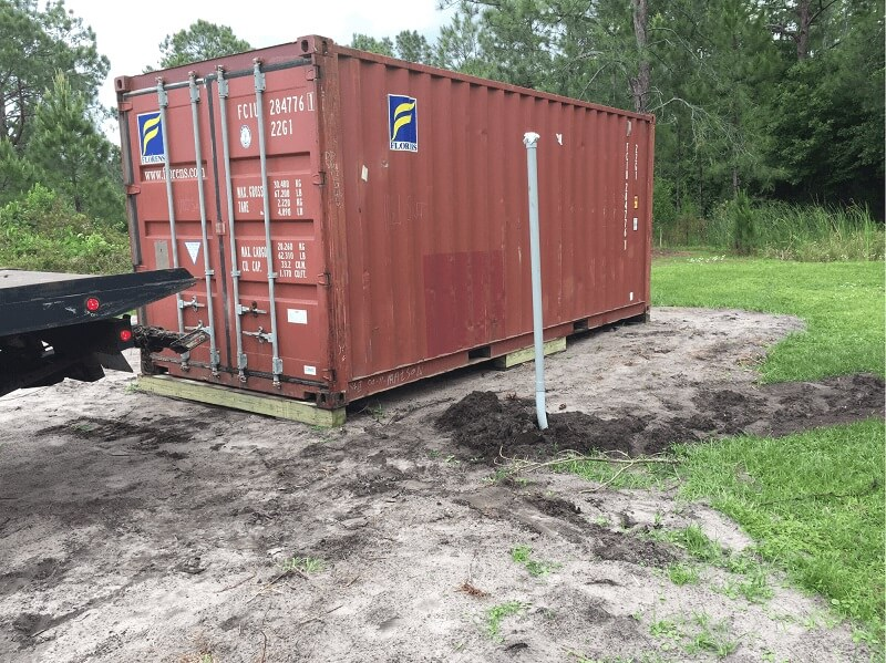 shipping container on wood blocks
