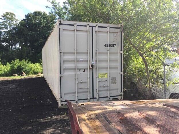White Storage Container in yard unloaded.