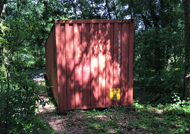 Red storage container in woods
